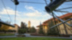 A blurred image of Stanford University's Hoover Tower and former Meyer Library
